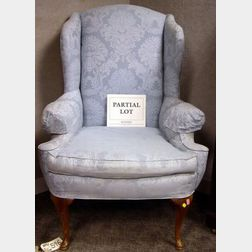 Queen Anne Style Upholstered Fruitwood Wing Chair and a Chippendale-style Upholstered Carved Mahogany Easy Chair.