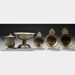 Three Pewter Porringers, a Syrup Pitcher, and a Compote
