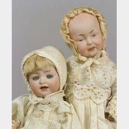 Two Small Bisque Head Baby Dolls