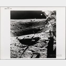 Apollo 16, Astronaut John W. Young Stands on the Rim of Plum Crater While Collecting Lunar Samples at Station 1, April 21, 1972.