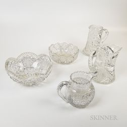 Three Brilliant-cut Colorless Glass Pitchers and Two Bowls.     Estimate $400-600