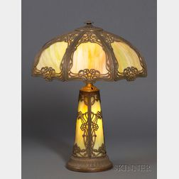Art Nouveau Patinated Cast Metal and Bent Green Slag Glass Panel Table Lamp