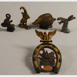 Three Figural Cast Iron Bottle Openers, a Shell-form Bank, and Horseshoe Plaque