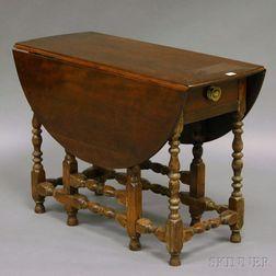 William & Mary-style Beechwood Drop-leaf Gate-leg Table.     Estimate $200-300