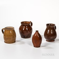 Three Redware Pitchers and a Redware Flask with Cork