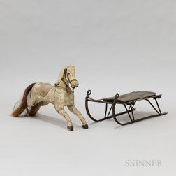 Wrought Iron and Wood Sled and a Carved Hobby Horse