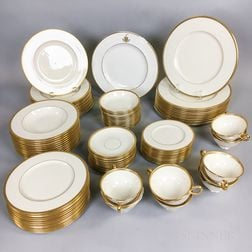 Lenox Gilt-rimmed Porcelain Dinner Service for Twelve.     Estimate $200-300