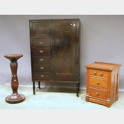 Mahogany-finished Gentlemans Wardrobe Cabinet, Carved Hardwood Pedestal, and a Walnut Three-drawer Chest.