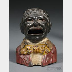 """Painted Cast Iron """"Uncle Tom"""" Mechanical Bank"""