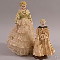 Two Molded Bisque Shoulder Head Dolls