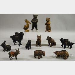 Twelve Painted Cast Iron and Metal Animal Figural Still Banks