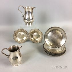 Twelve Sterling Silver Dessert Plates, Two Sterling Silver Floriform Dishes, and Two Silver-plated Pitchers