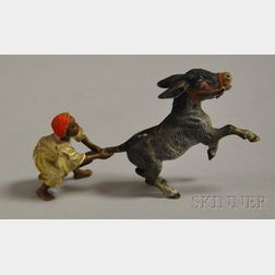 Austrian Miniature Cold-painted Bronze Figure of an Arab Boy Pulling the Tail of a   Rearing Donkey