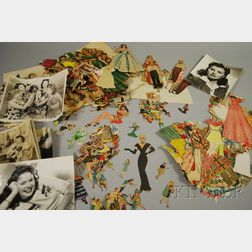 Collection of 1940s Movie Star and Other Paper Dolls and Nine 1940s Black and White   Movie Studio Publicity Photographs