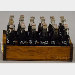 Miniature Set of Twenty-four Coca-Cola Glass Bottles in a Wood Carrier Crate