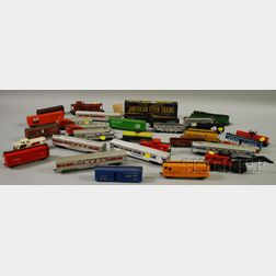 Group of Toy Train Locomotives, Cars, and Assorted Material