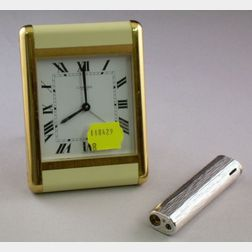 Cartier Paris Brass and Enamel Travel Alarm Clock and a Tiffany & Co. Lighter.