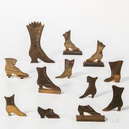 Twelve Brass High-top Shoe-form Items