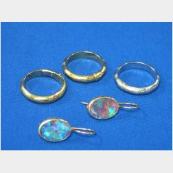 Pair of Opal Earrings and Three Gold Bands.