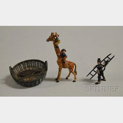 Austrian Miniature Cold-painted Bronze Figure of a Chimney Sweep, a Comic Characters Climbing a Giraffe Figural, and a Silver Wirework