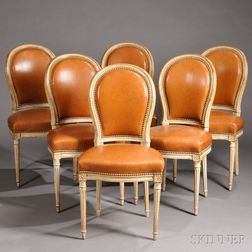 Six Leather-upholstered Louis XVI-style Side Chairs