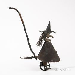 Carved Witch on a Bicycle Push Toy