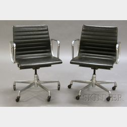 Two Eames Aluminum Office Chairs