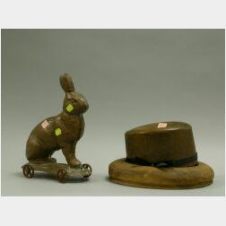Wooden Fedora Hat Mold and a Molded Copper Rabbit on Wheels.