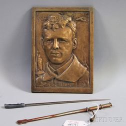Commemorative Charles Lindbergh Bronze Portrait Plaque and a Miniature   Metal Sword with Scabbard Letter Opener
