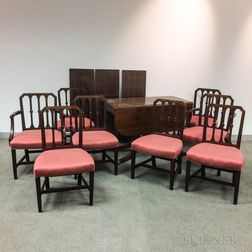 Classical-style Carved and Inlaid Mahogany Dining Table and a Set of Eight Federal-style Mahogany Chairs.     Estimate $600-800