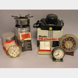 Minolta Hi-matic 9 35mm Camera, Four Assorted Table Clocks, and a Coleman Aluminum   G.I. Pocket Stove