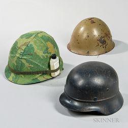 Three 20th Century Military Helmets