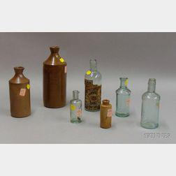 Four Aqua Molded Glass and Three Glazed Stoneware Master Ink Bottles
