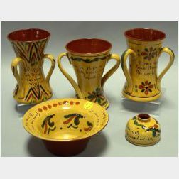 Aller Vale Motto Ware Daisy Bowl, Ink Pot, and Two Three-Handled Vases, and a Torquay Motto Ware Three-Handled Vase.