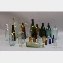 Twenty-eight Assorted Colored and Colorless Glass Bottles