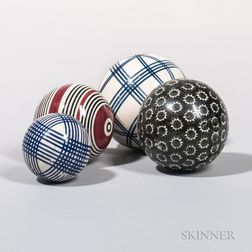 Four Glazed Ceramic Carpet Balls