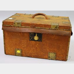 Brass-mounted Leather-clad Trunk