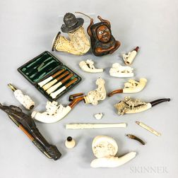 Seventeen Carved Meerschaum and Wood Pipes and Cheroot Holders.     Estimate $300-500