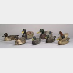 Eight Assorted Carved and Painted Wooden Duck Decoys