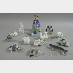 Thirteen Royal Copenhagen Animal Figurines and a Royal Doulton Figure of a Victorian   Lady