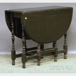 Black-painted William & Mary-style Drop-leaf Gate-leg Table.