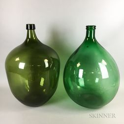 Two Green Glass Demijohns