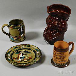 Buffalo Pottery Deldare Ware Mug and Plate, a Doulton Lambeth Mug, and a Rockingham-glazed Toby Jug