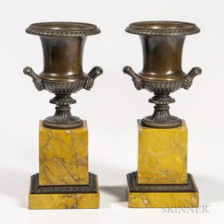 Pair of Bronze Urns on Marble Plinths
