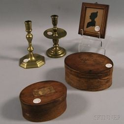 Two Small Covered Oval Boxes, Two Brass Candlesticks, and a Silhouette