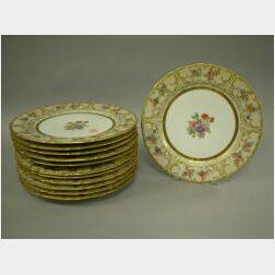 Set of Twelve Limoges Gilt and Floral Decorated Porcelain Dinner Plates.