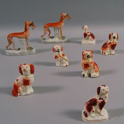 Eight Staffordshire Pottery Dogs