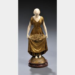 Joe Descomps (French, 1869-1950)       Gilt-bronze and Ivory Figure of a Woman with Flowers