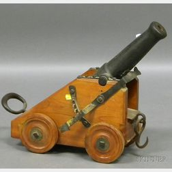 Cast Iron and Cherry Signal Cannon