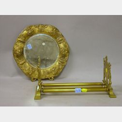 Renaissance Revival Brass Adjustable Book Rack and an Art Nouveau Round Gilt-metal Wall Mirror.
